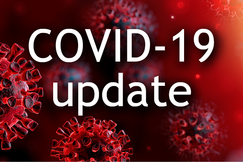 """A graphic reading """"COVID-19 update"""" with red germs in the background."""